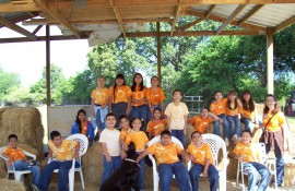 A group of students enjoying their field trip to the farm.