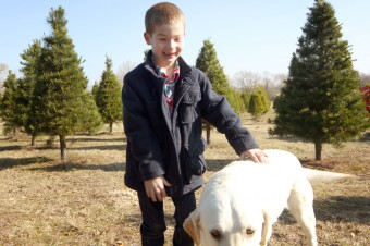 boy-having-fun-with-dog-on-farm